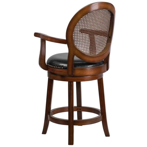 Woven Rattan Back and Black Leather Swivel Seat