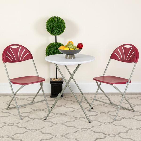 Lowest Price HERCULES Series 650 lb. Capacity Burgundy Plastic Fan Back Folding Chair