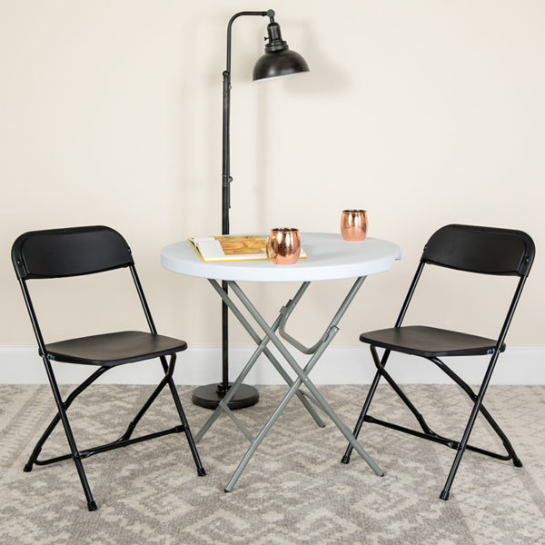 Lowest Price HERCULES Series 650 lb. Capacity Premium Black Plastic Folding Chair