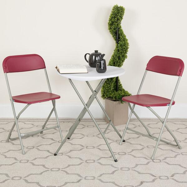 Lowest Price HERCULES Series 650 lb. Capacity Premium Red Plastic Folding Chair